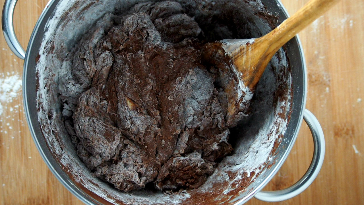 More flour is added to form a soft, shaggy dough.