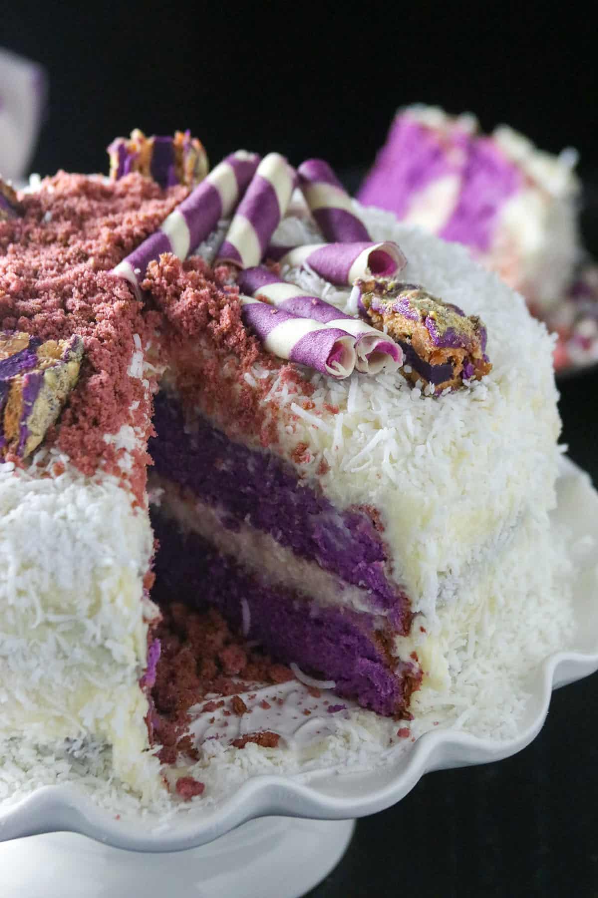 Close up shot of ube cake with white chocolate coconut cream.
