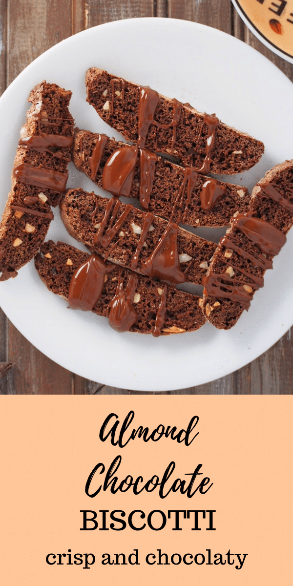 Thin and crisp chocolate biscotti with speckles of slivered almonds, these almond chocolate biscotti are the perfect match for your morning coffee. #biscotti #chocolatebiscotti #almondbiscotti