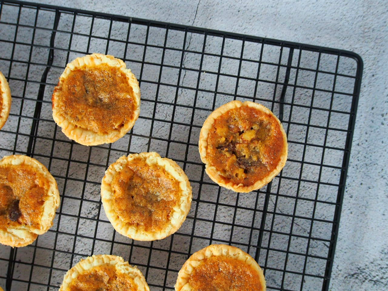 cooling the butter tarts on a wire rack.