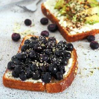 Blueberry breakfast toast with hemp seeds sprinkled on top.