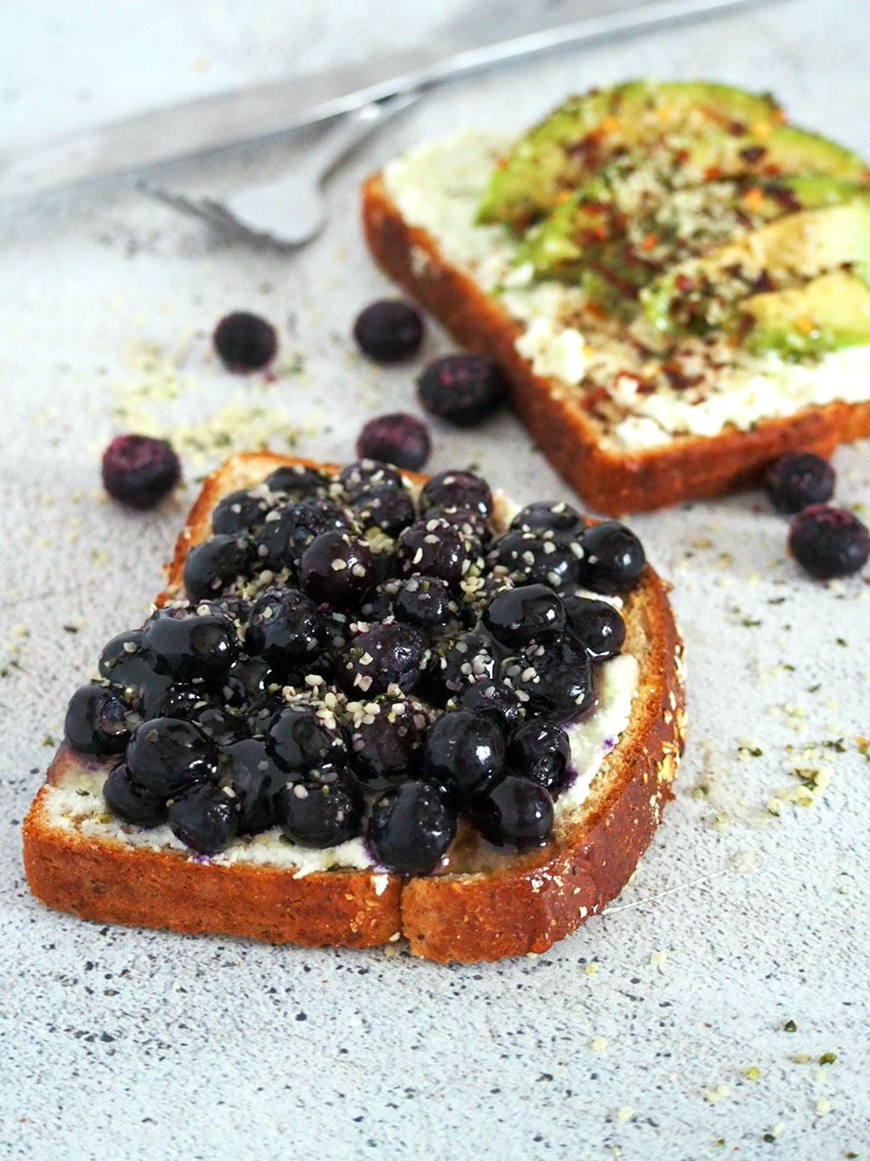 Blueberry breakfast toast with hemp seeds sprinkled on top.