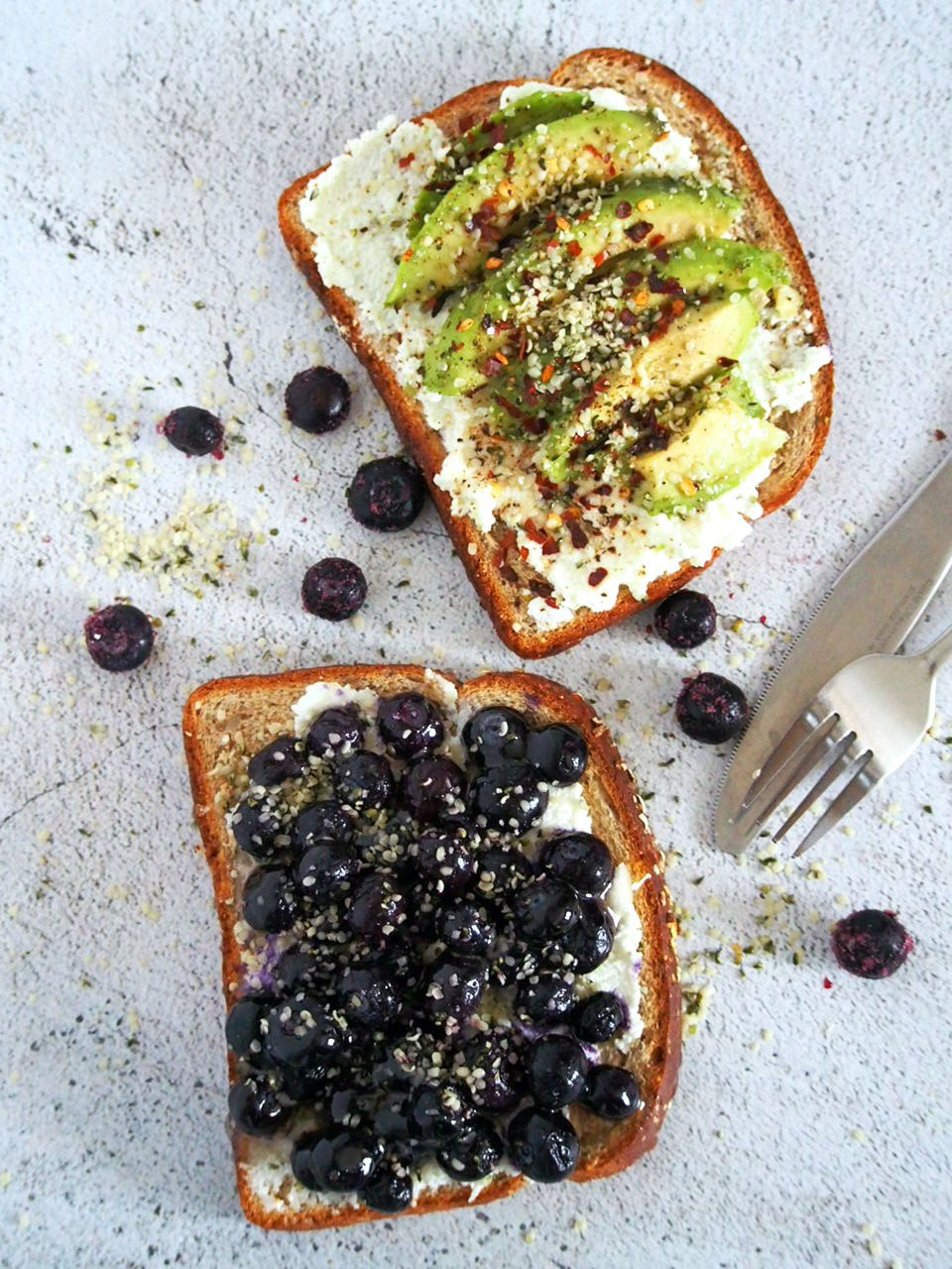 Top view of the avocado and blueberry toasts.