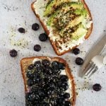 Top view of avocado and blueberry toasts.