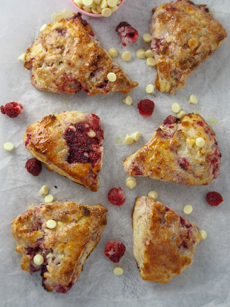 Top angle shot of Raspberry white chocolate scones.