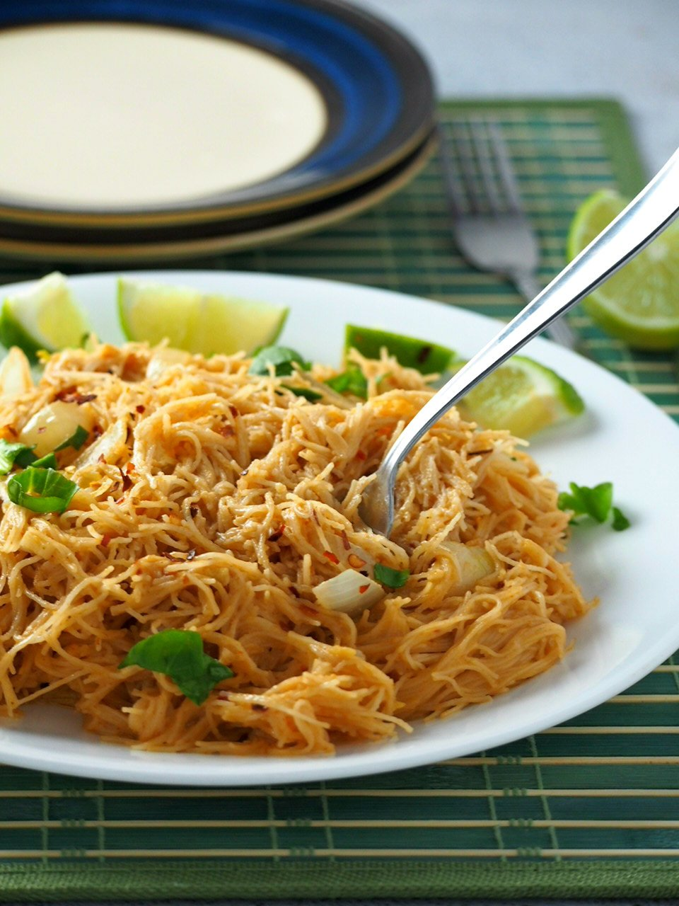 Serving Pad Thai with lime wedges.