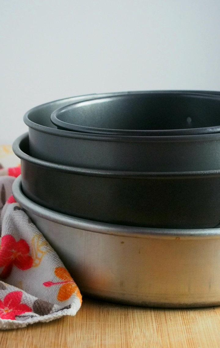 Stacked round baking pans.