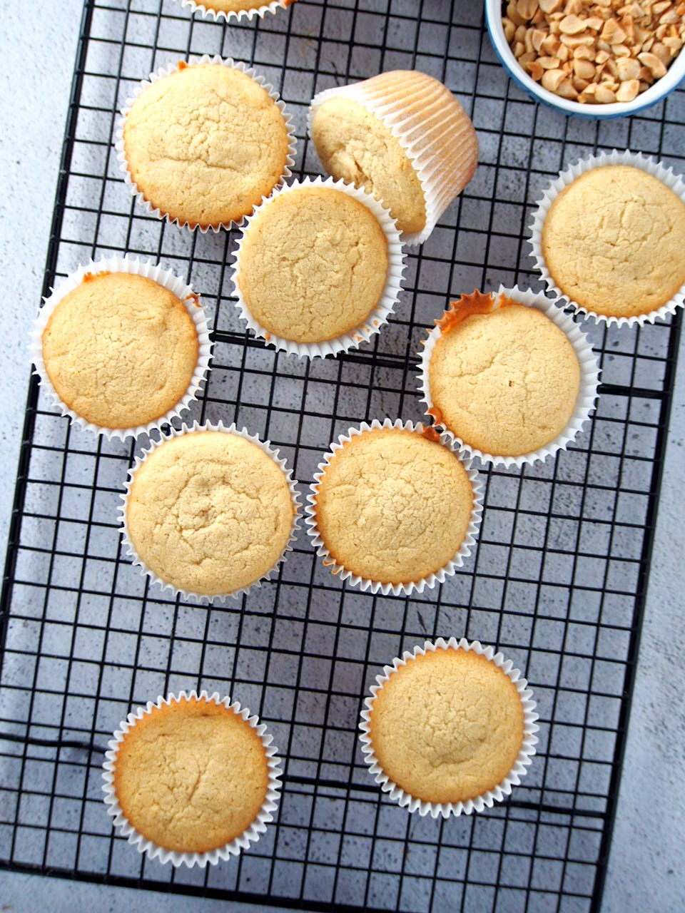 Peanut butter cupcakes ready for glazing and toppings.