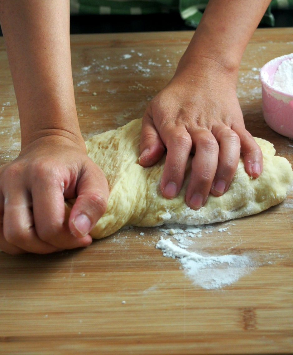 Kneading dough by hand.