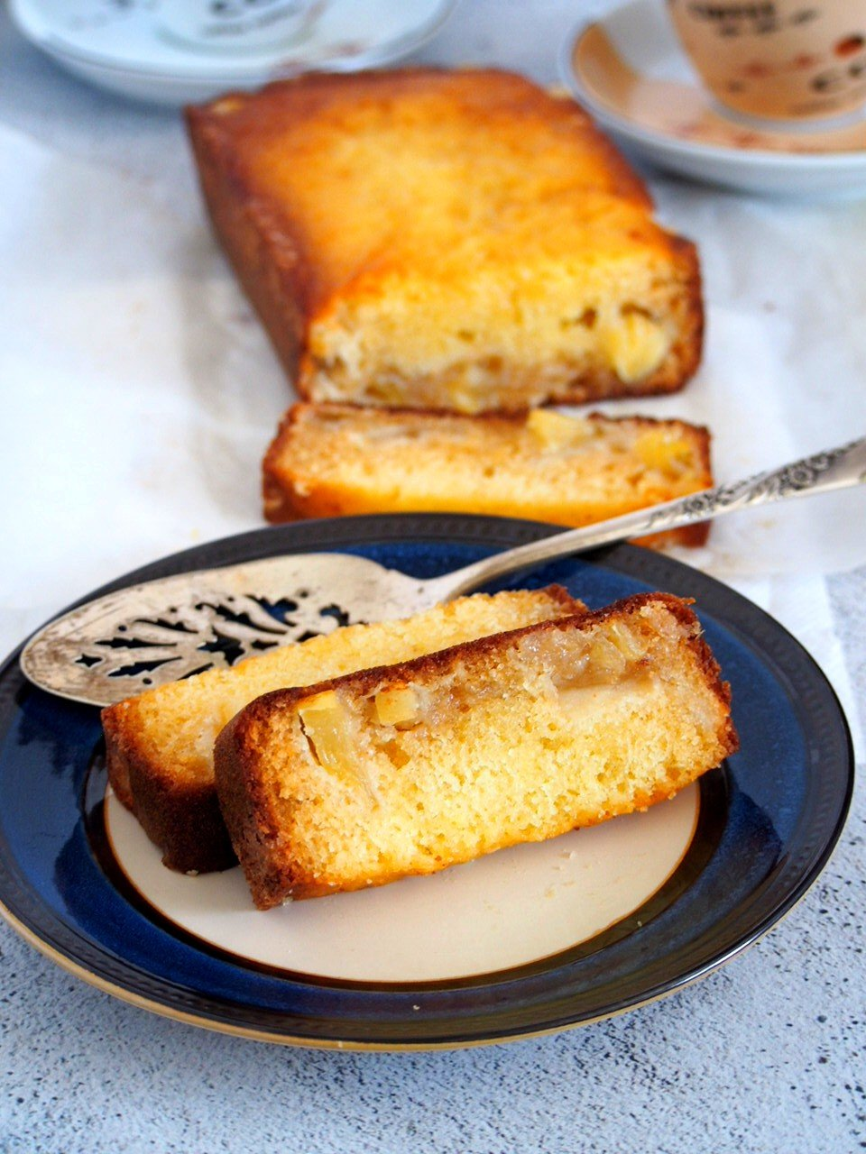 Two slices of Pineapple Loaf cake on a plate.