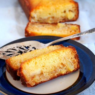 Slices of the Pineapple Loaf Cake on a saucer plate.