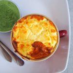 Top shot of the goat cheese souffle showing the crackly top.