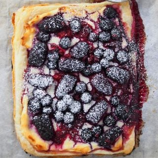 Berry Tart dusted with powdered sugar.