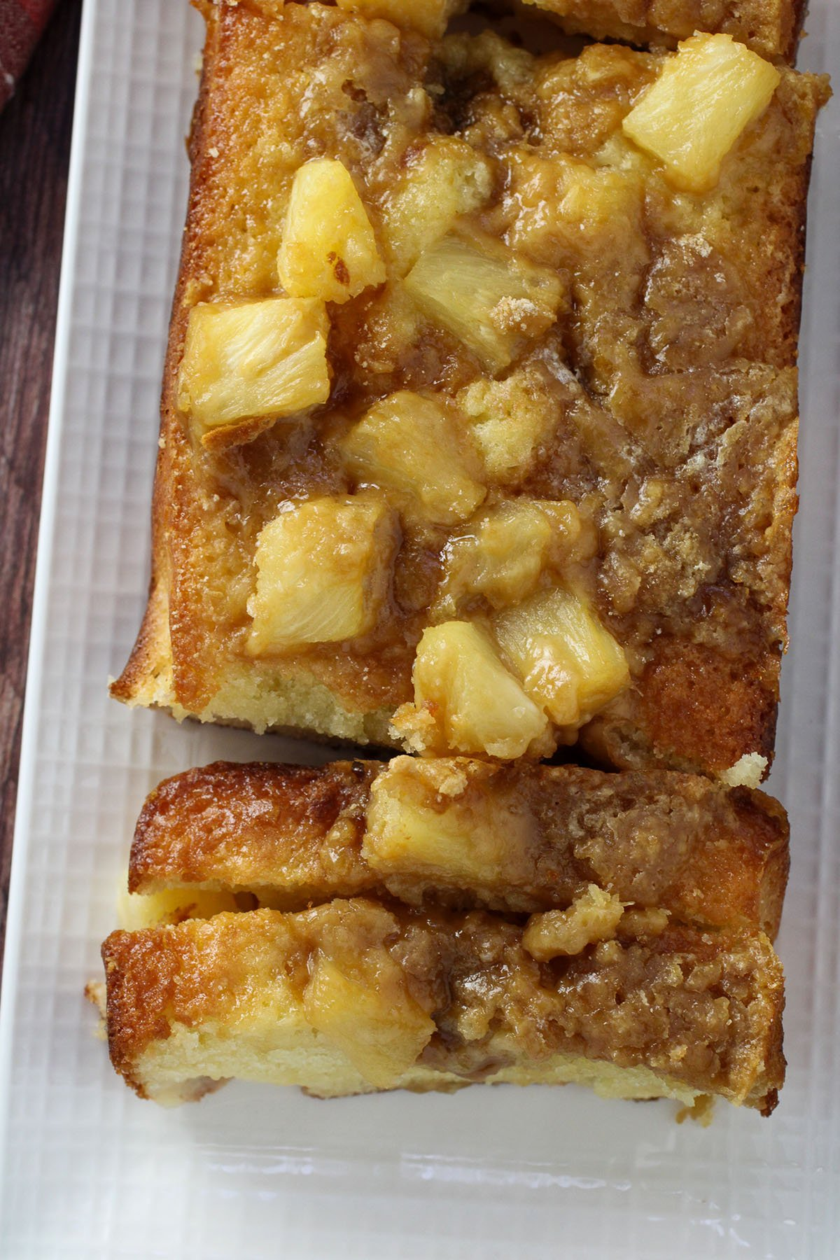 Top view of sliced pineapple loaf cake.
