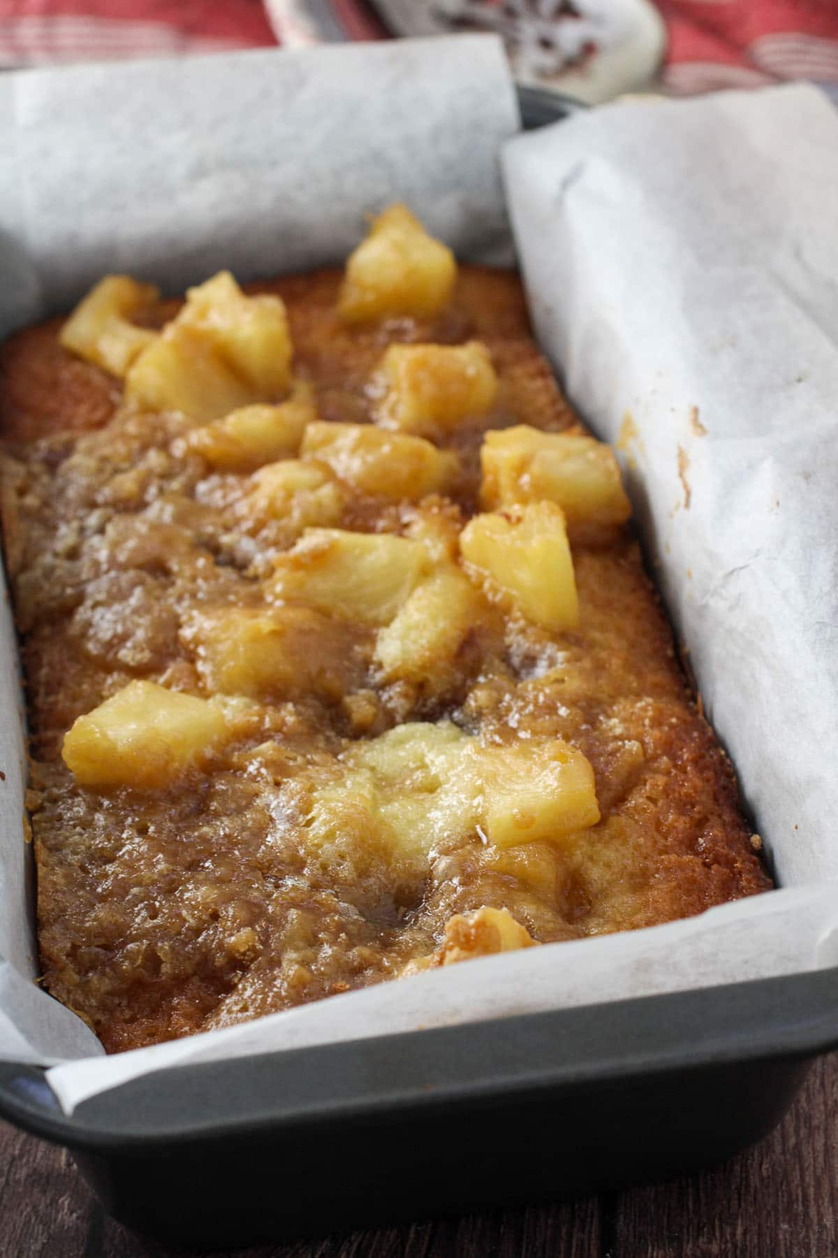 Freshly baked Pineapple loaf cake in a pan.
