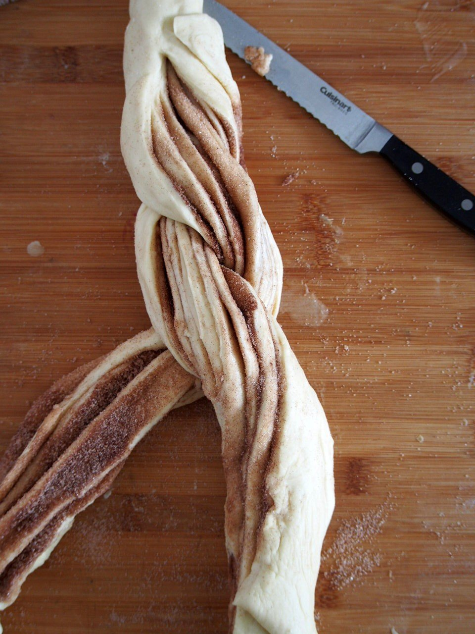 Braiding the cinnamon bread dough.