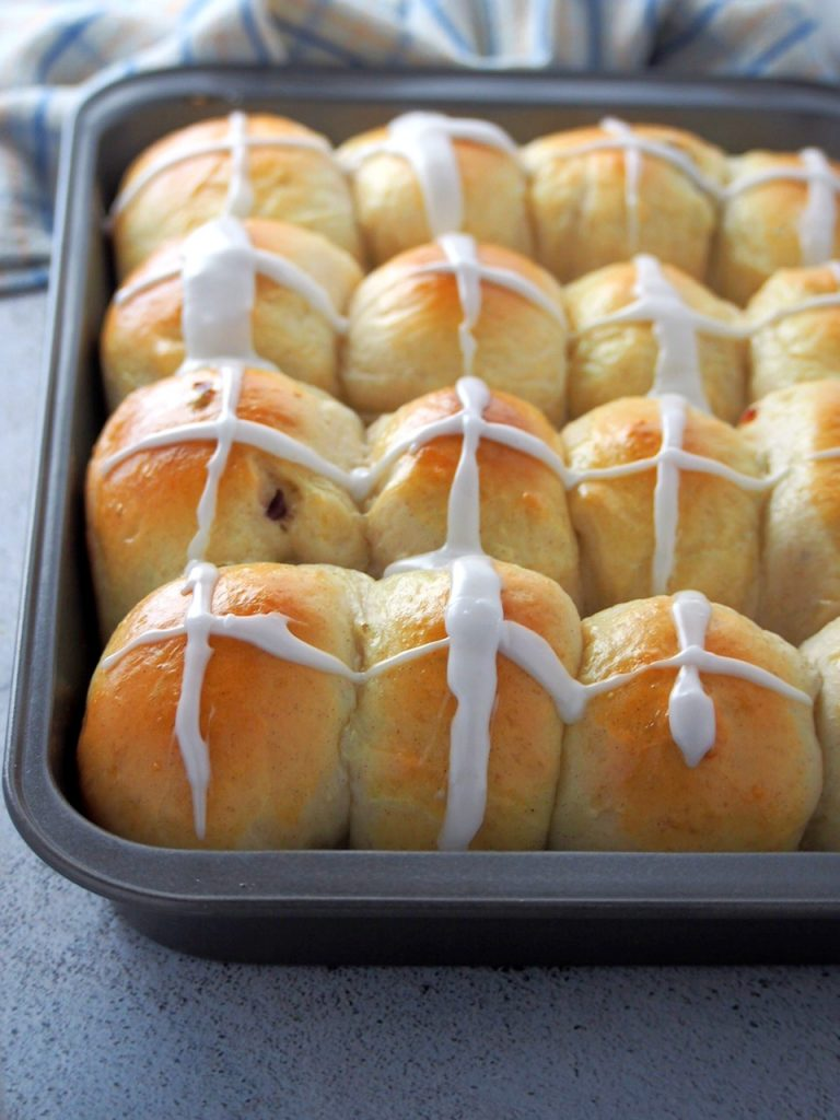 Close shot of the hot cross buns in the baking tray.