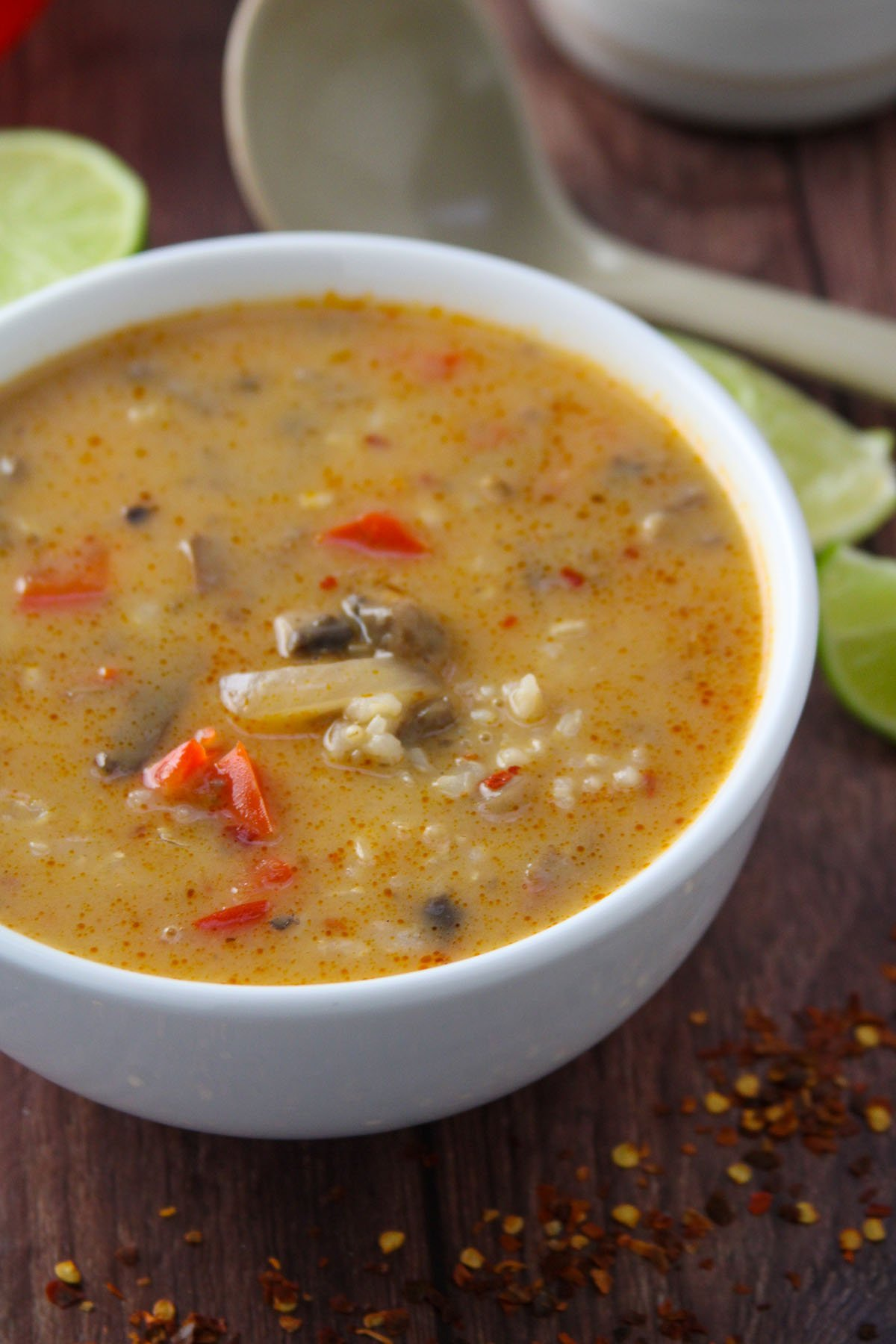 A bowl of mushroom and rice spicy Thai soup.