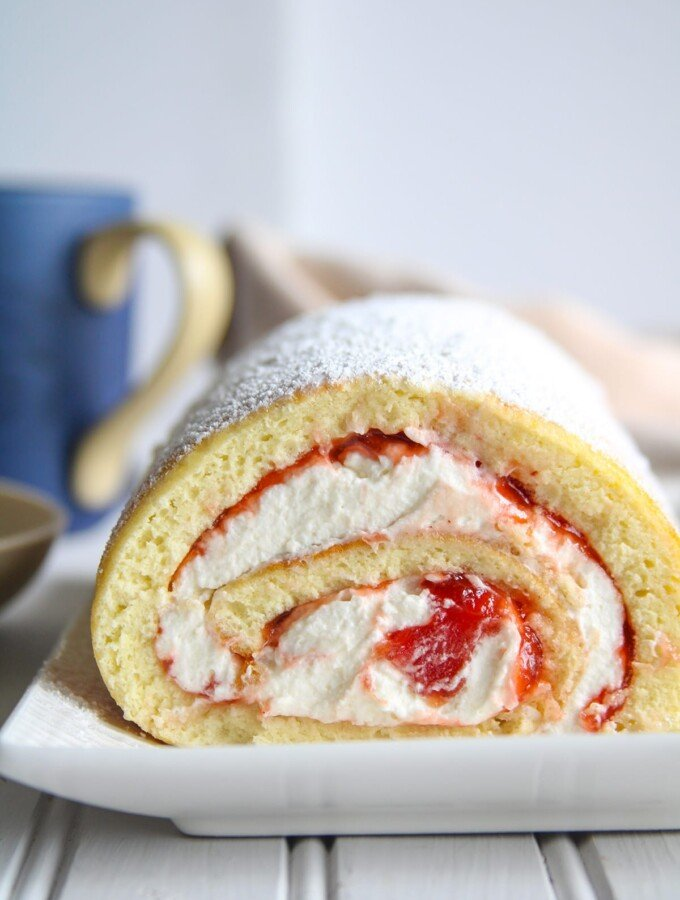close up shot of Vanilla Swiss Roll on a serving plate.