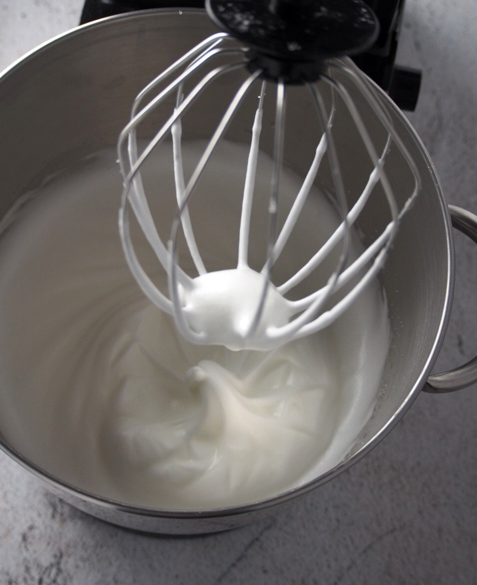 The beaten egg whites for the vanilla chiffon cake batter.