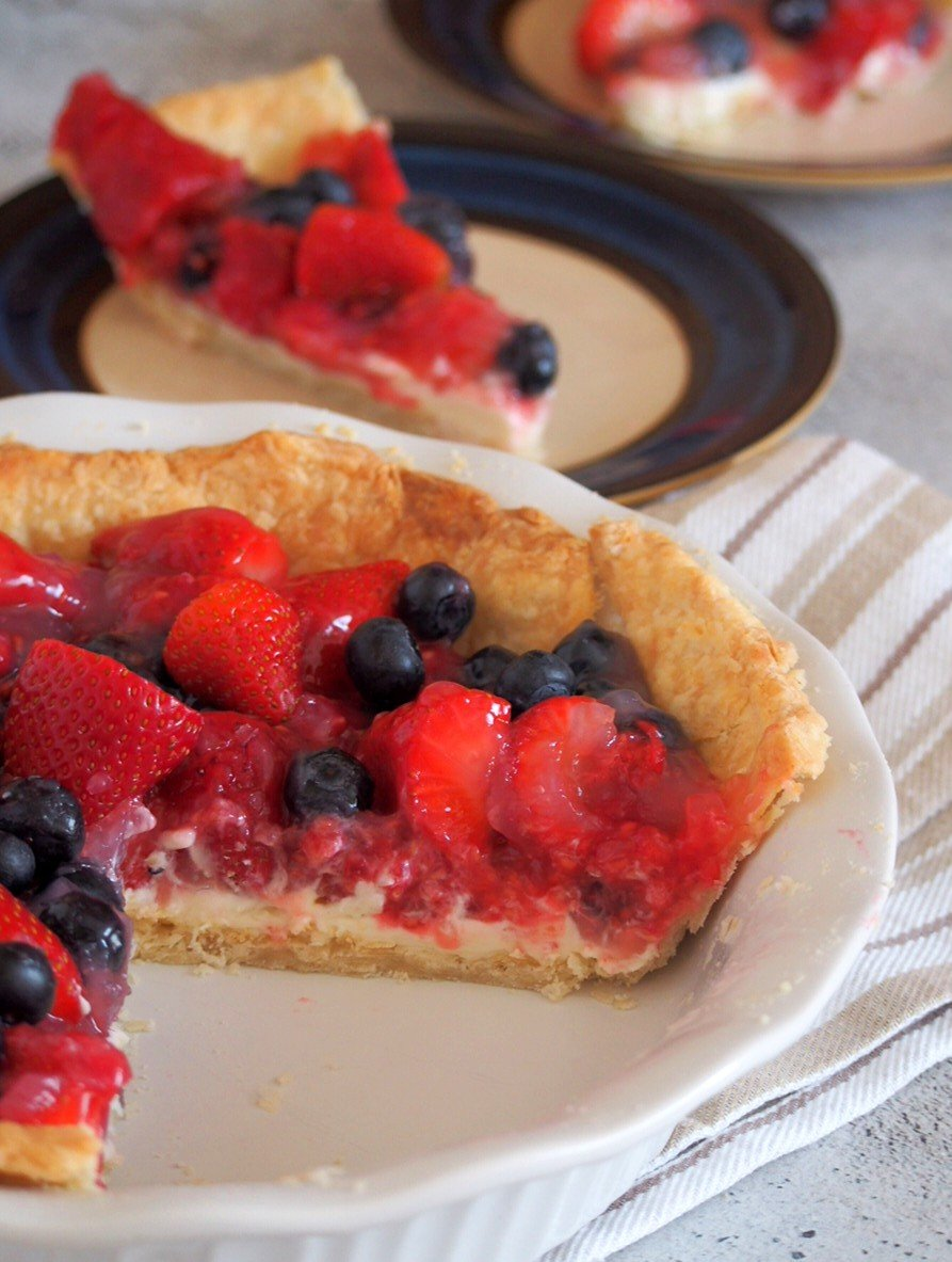 Sliced Glazed Triple Berry Pie.