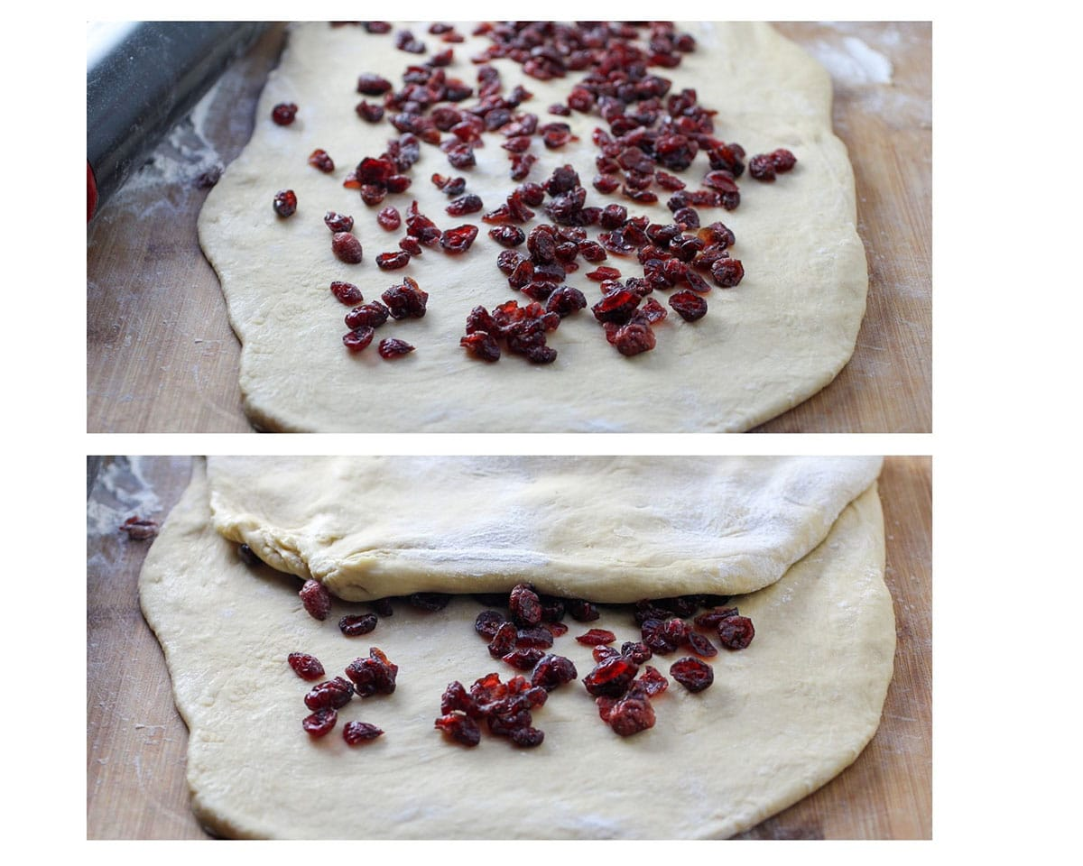 Folding the dough on thirds to cover the craisins.