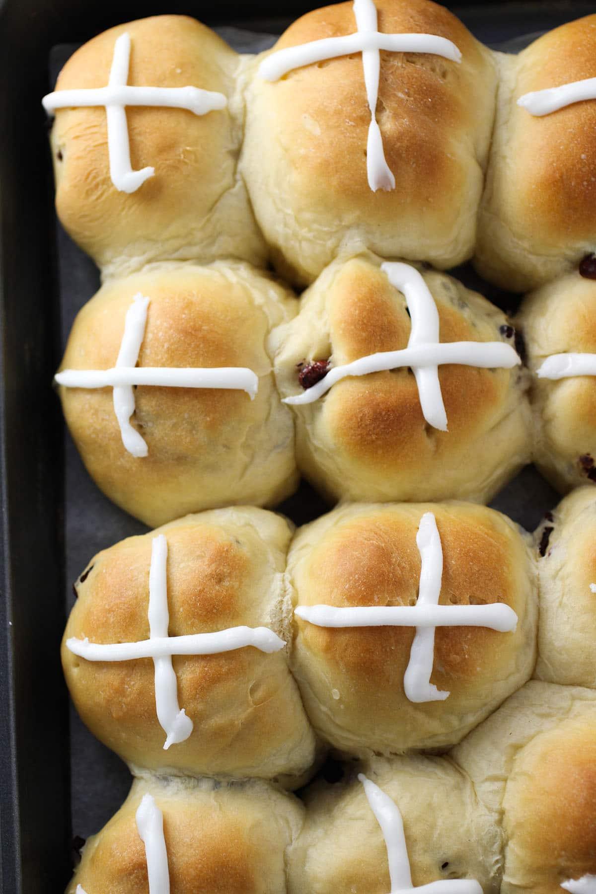 Top view shot  of hot cross buns.