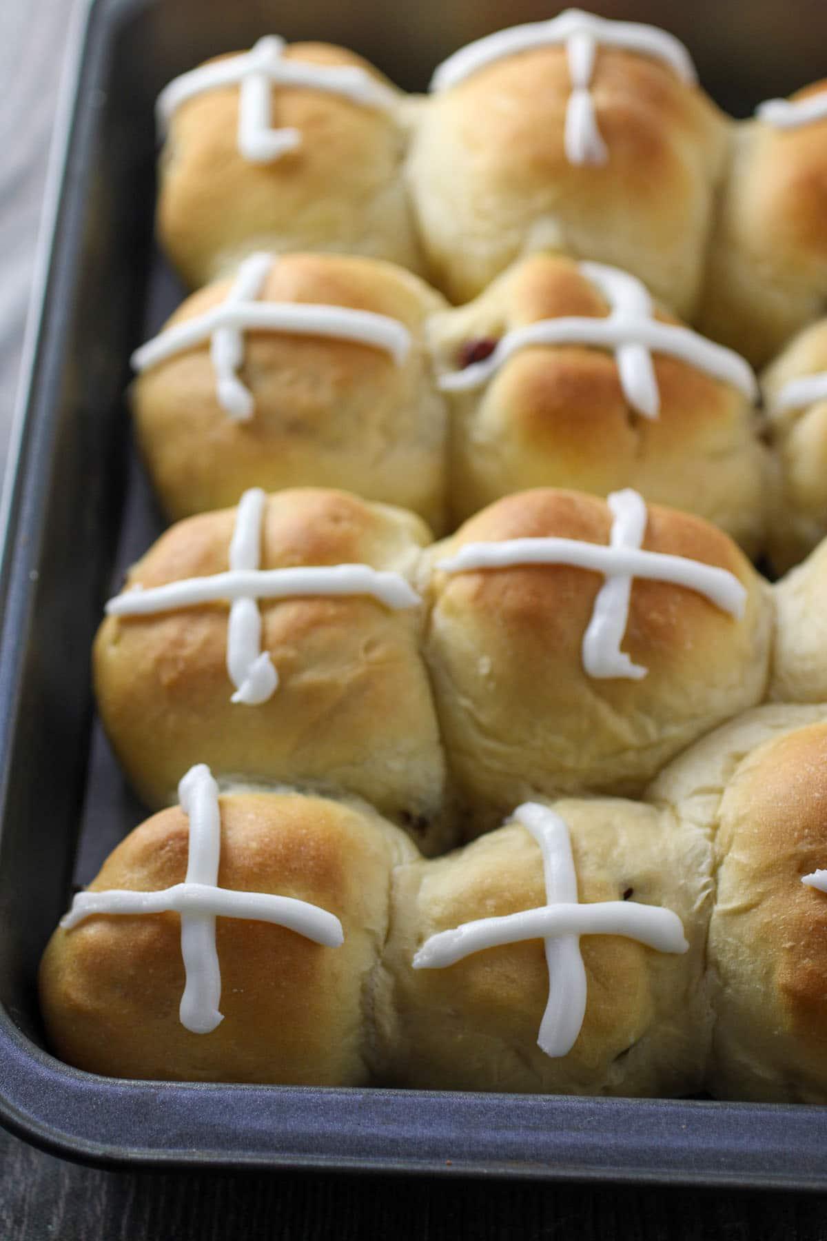 Hot cross buns on the baking pan.