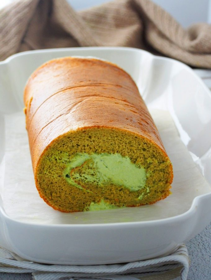 Matcha Roll cake on a serving plate.