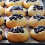 Finnish blueberry buns in the baking pan, freshly baked.