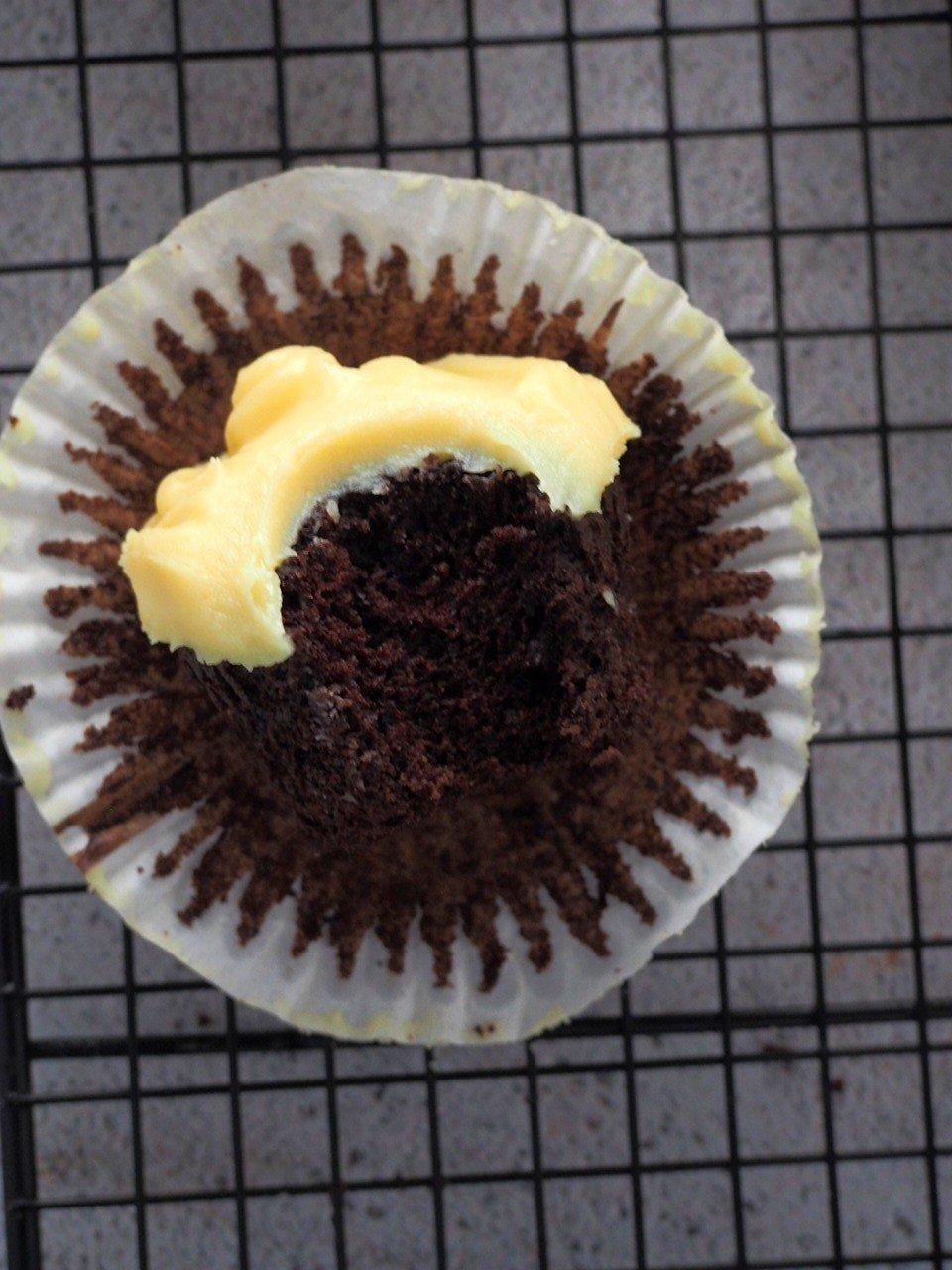 Bite shot of a choco-yema cupcake.