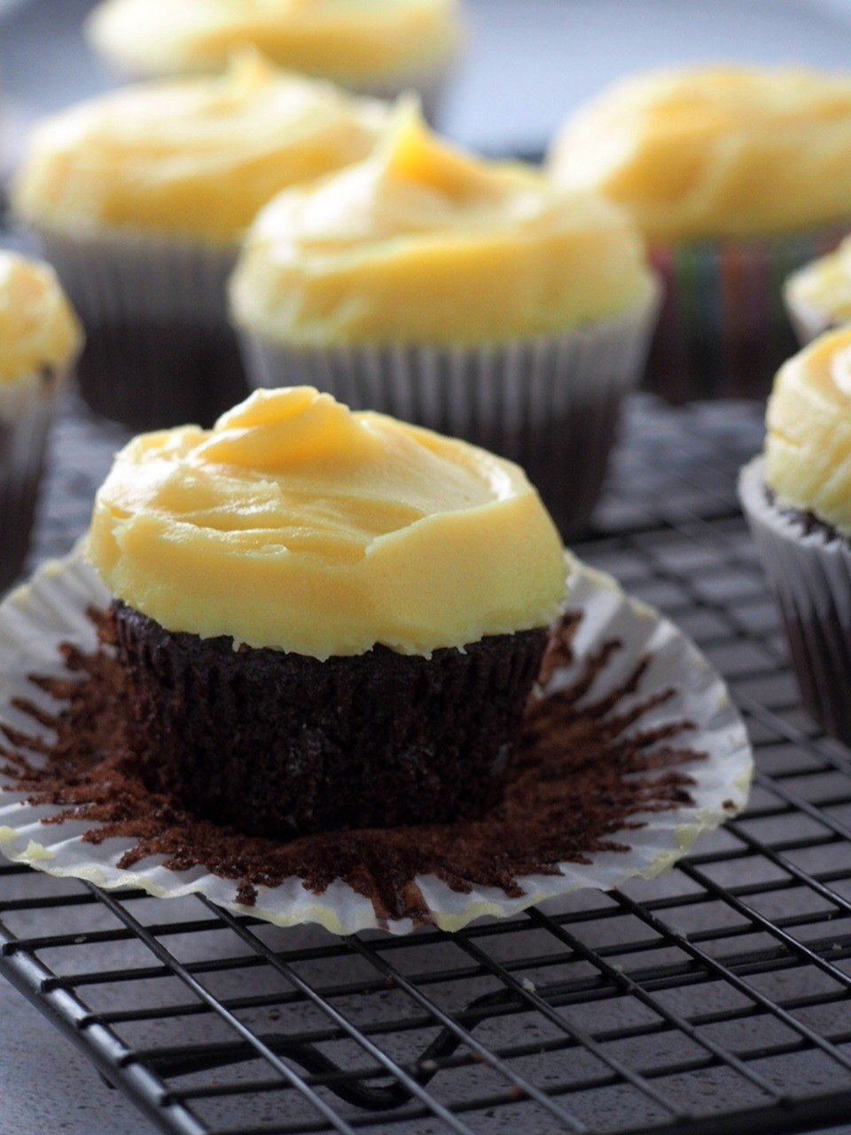 Choco-yema cupcake shot with the paper liner peeled, showing the crumbs.