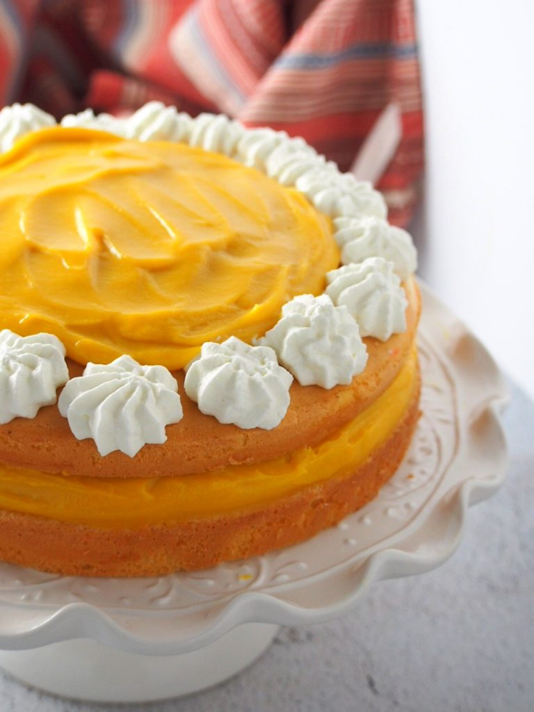 Close up shot of mango cream cake.