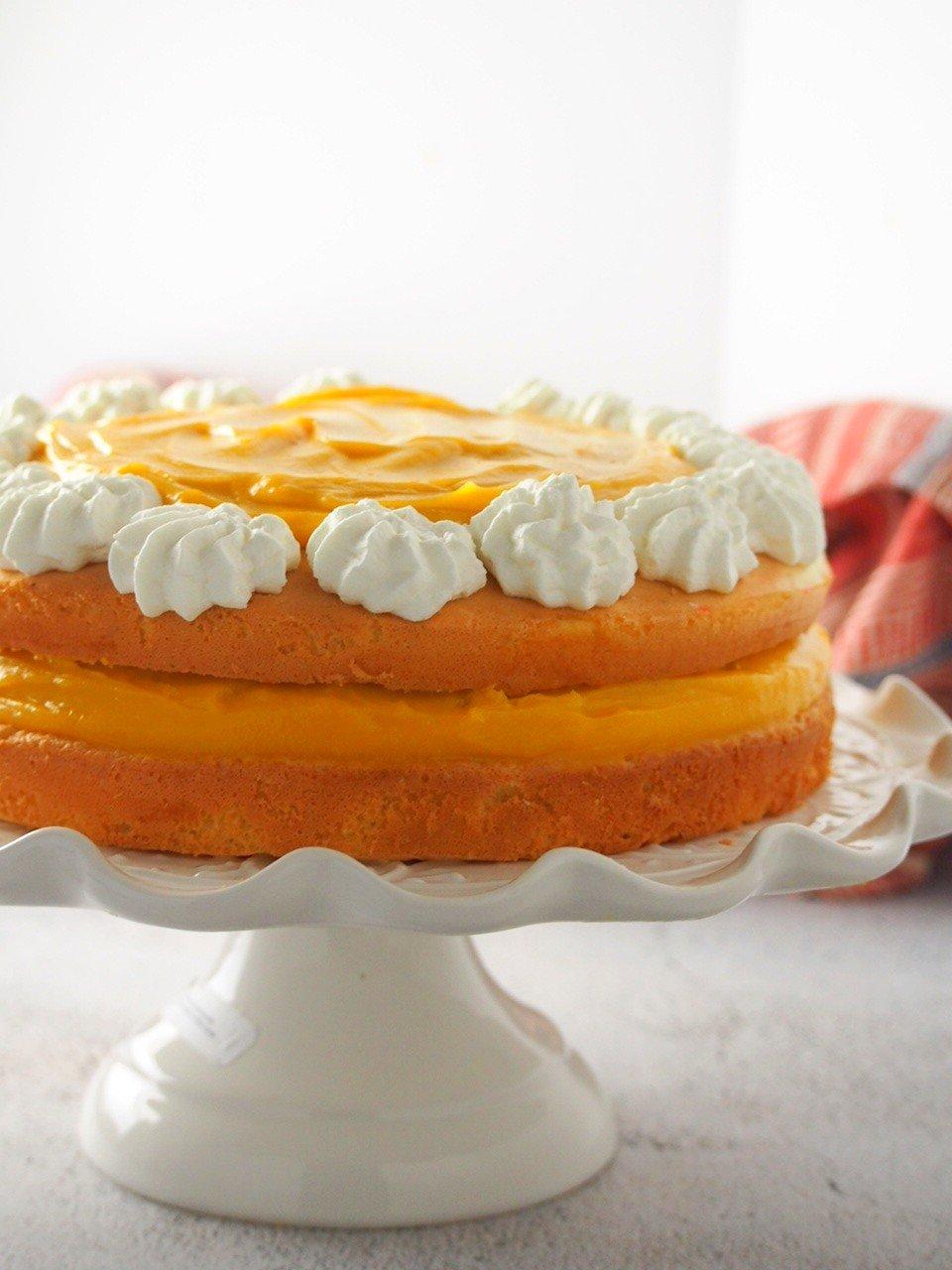 Mango Cream Cake on a cake stand.