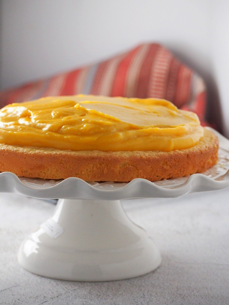 Mango Cream cake piled on top of a sponge layer.