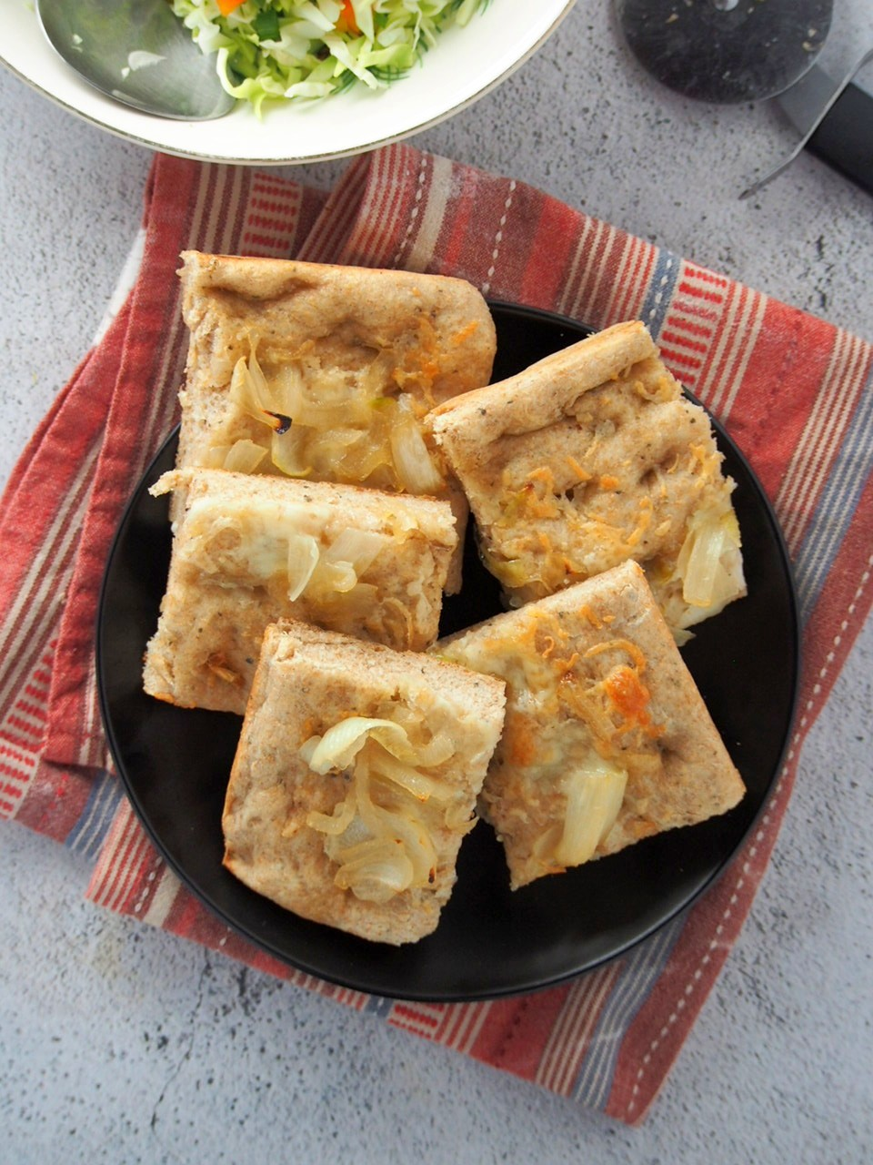 Slices of whole wheat focaccia on a plate.