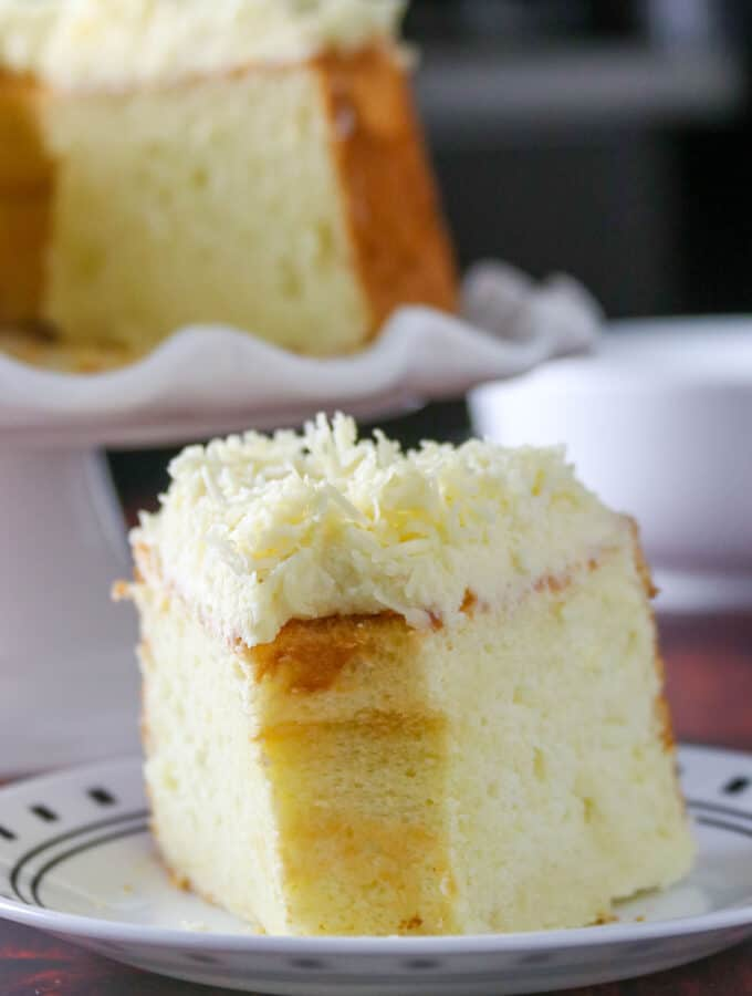 A slice of Cheese Chiffon Cake on a plate.