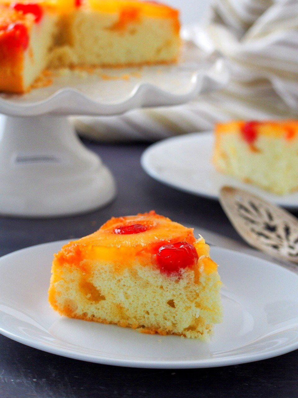 A slice of Pineapple Upside Down Cake on a plate.