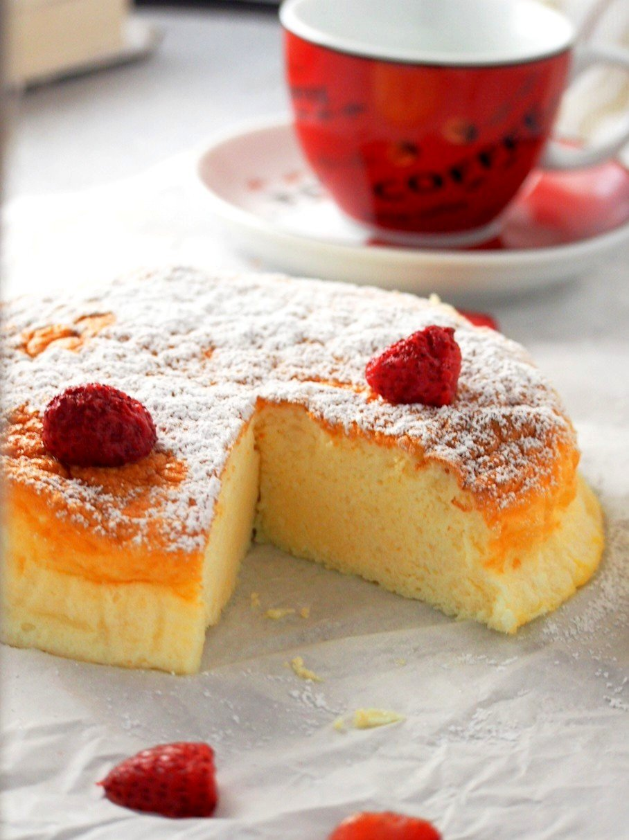 Condensed milk cheesecake with the inside crumb shown.