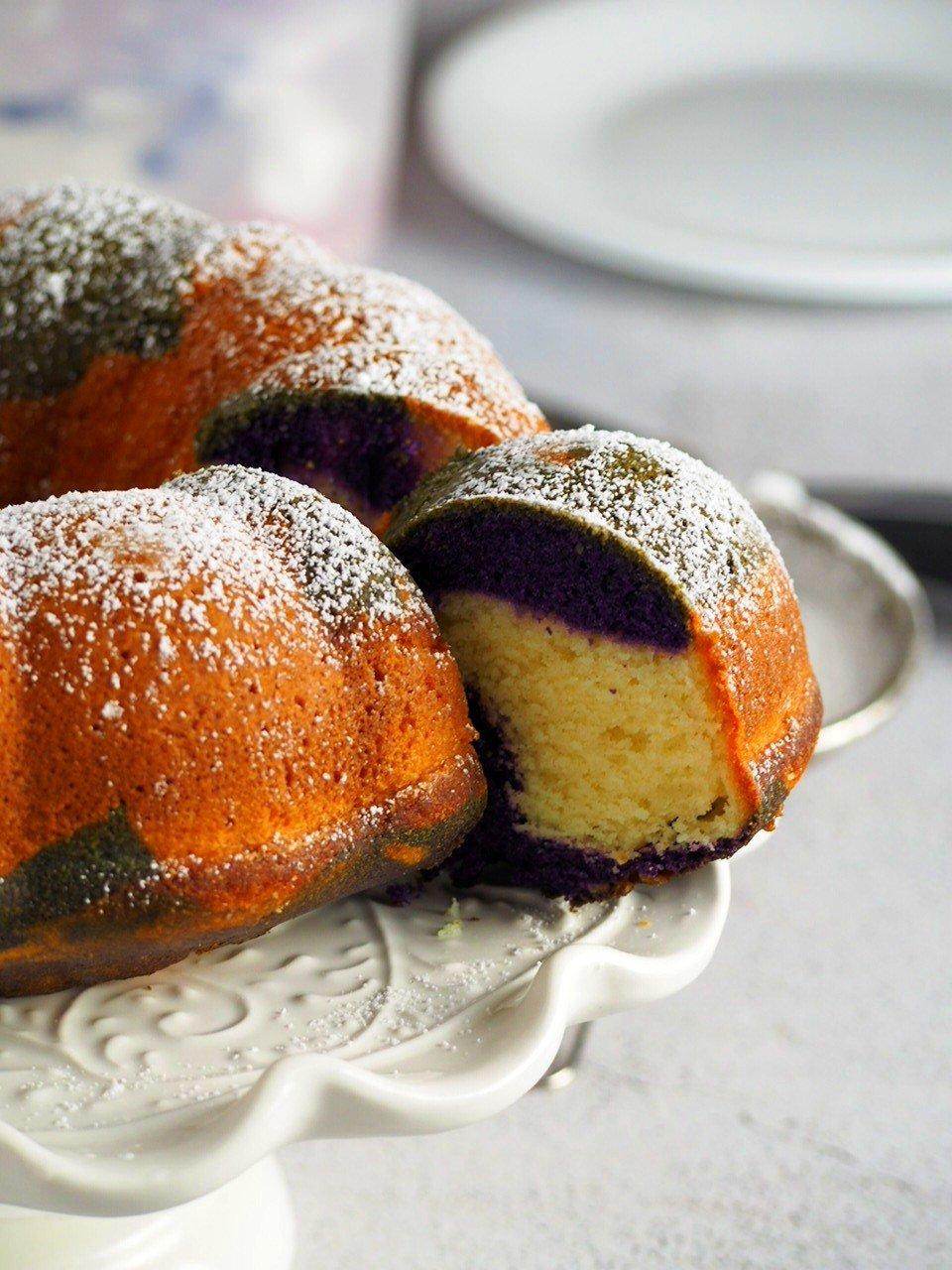 Slice shot uf ube marble bundt cake.