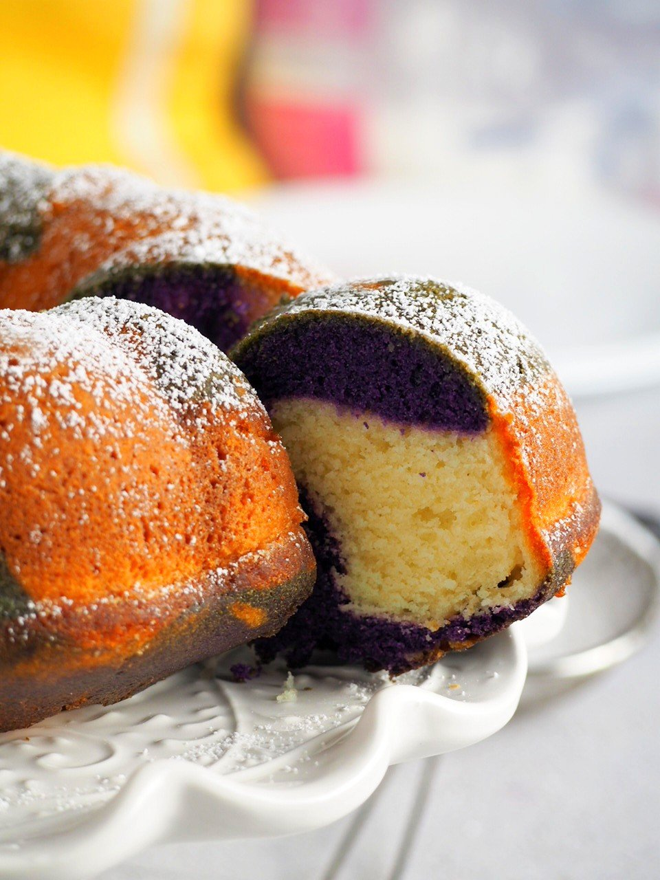 Close up of a sliced Ube Marble Bundt Cake.