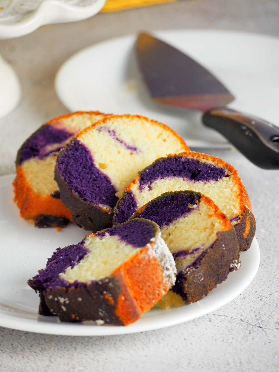 Slices of Ube Marble Bundt Cake arranged on a serving plate.