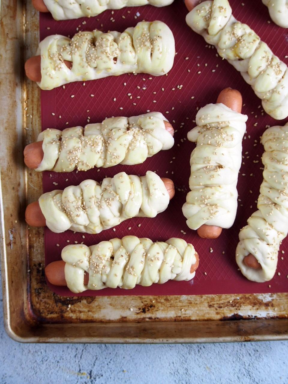 Braided hotdog buns ready for baking.