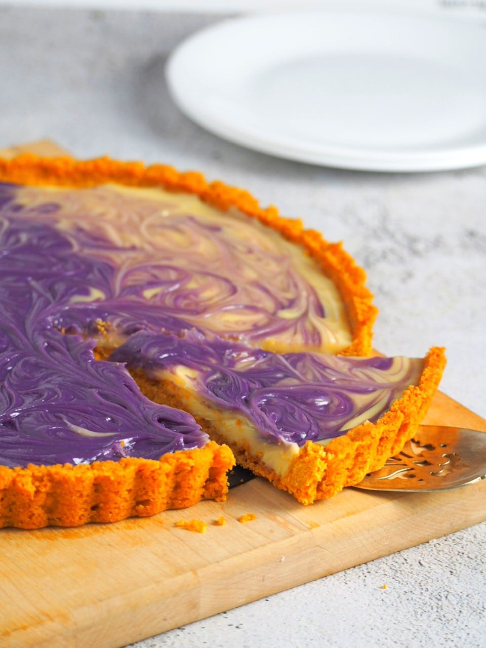 Ube Custard tart with one slice ready for serving.