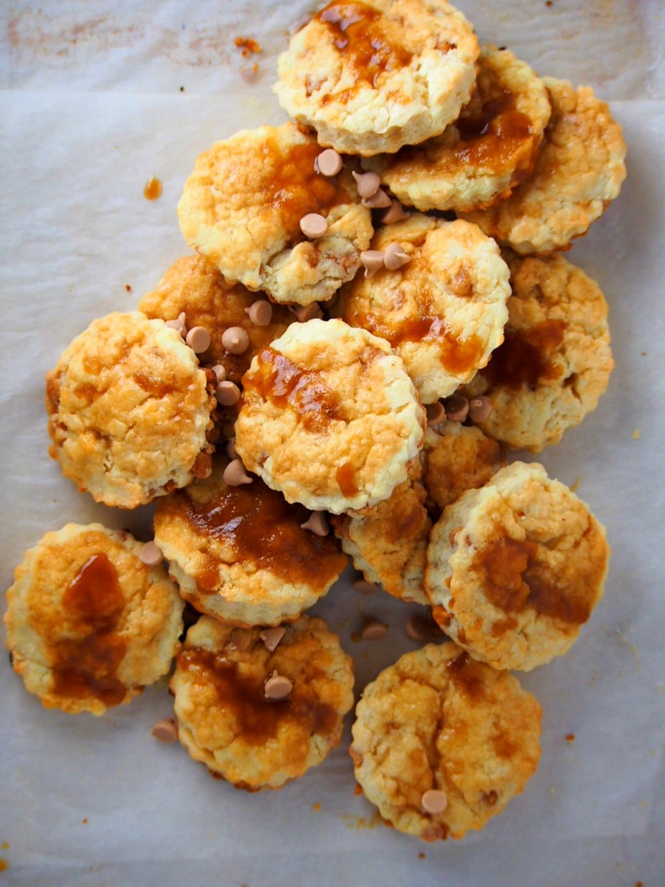 Salted caramel scones piled on a parchment paper.