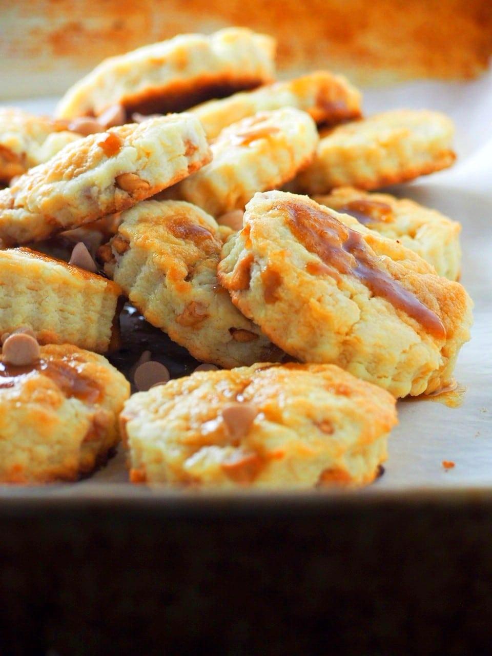 Closer shot of salted caramel scones on a baking pan.