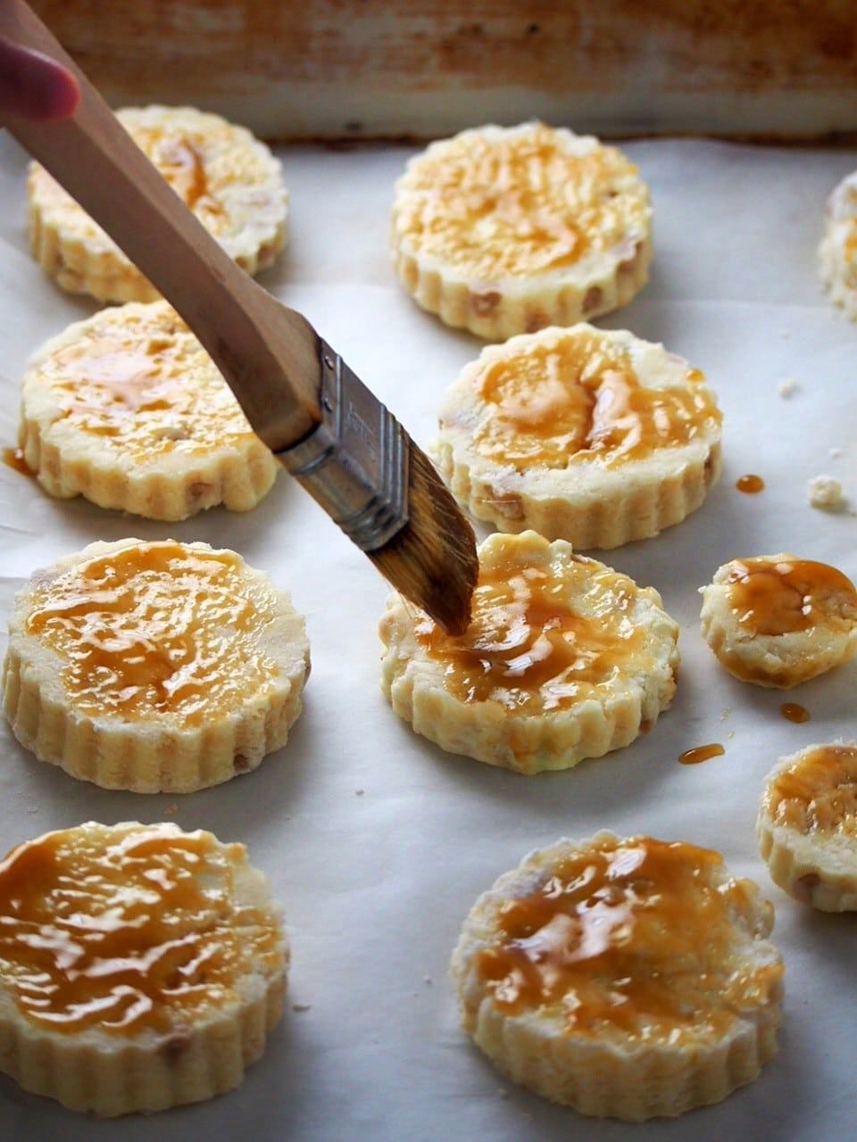 Brushing caramel sauce on the scones pastry.