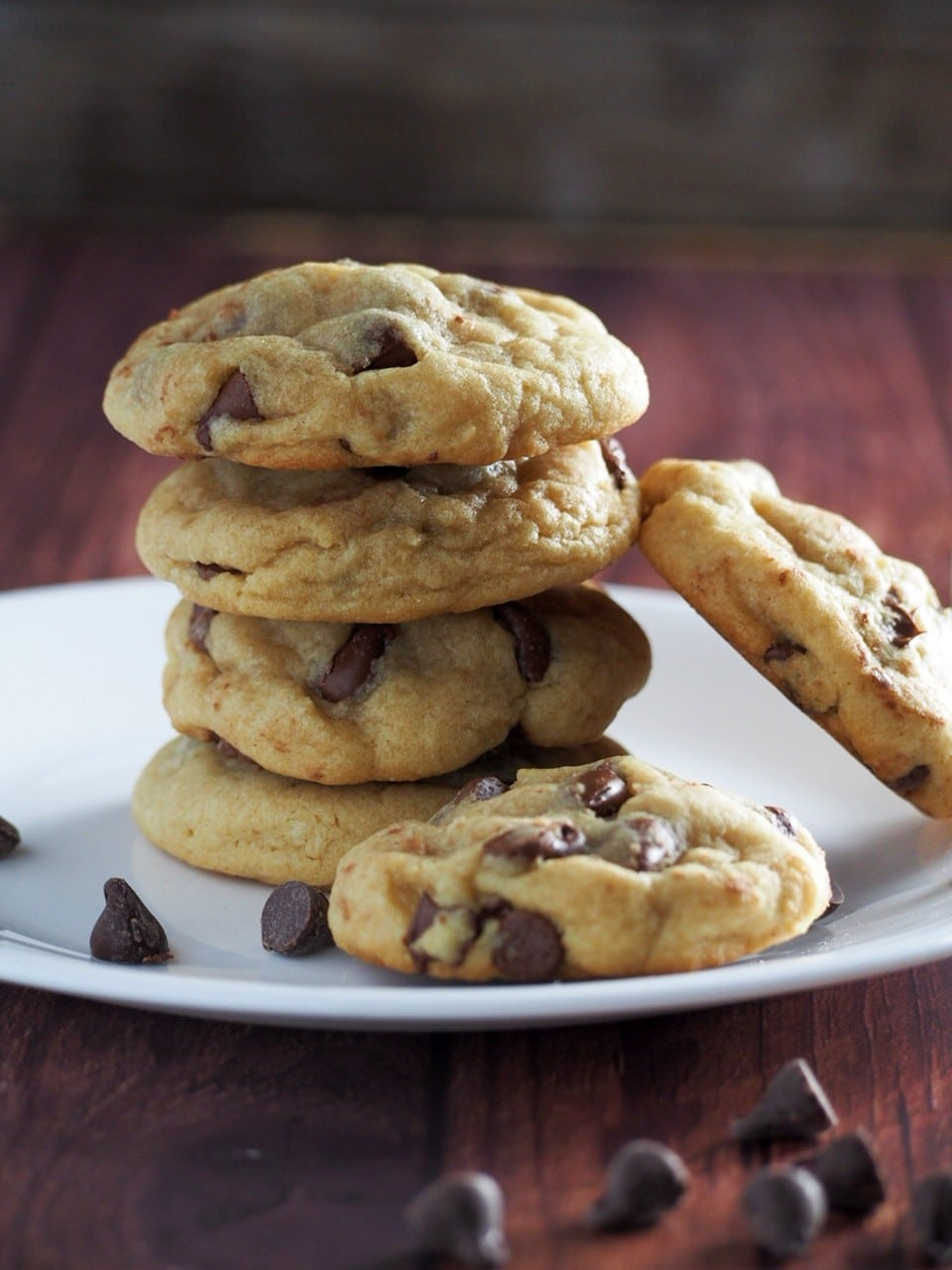 Nutella-filled chocolate chip cookies stacked on a plate.