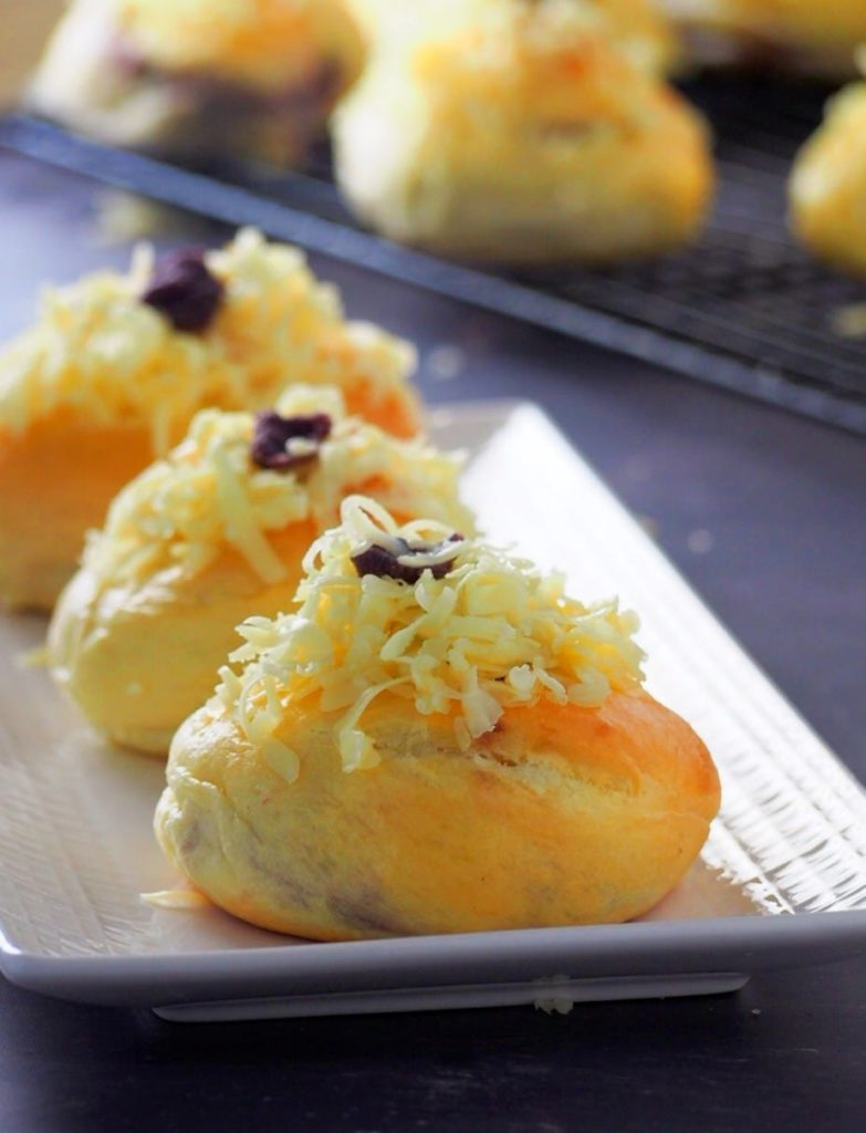 Ube ensaymada on a serving plate.