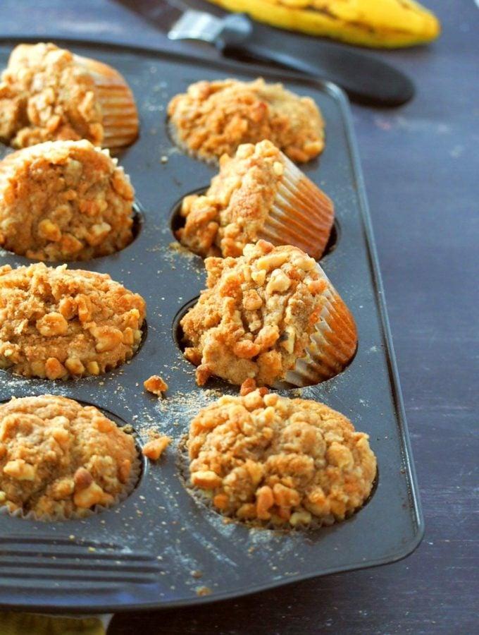 Banana bread cupcakes on a muffin pan.